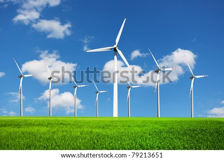 Wind Turbines on green field - stock photo