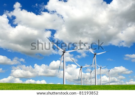 Wind turbines on green field