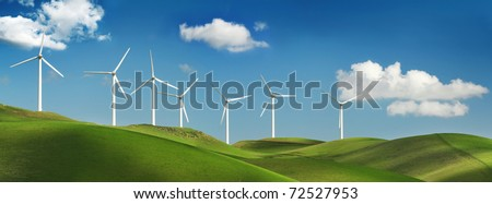 Wind turbines on green spring hills of California. Altamont Pass wind farm near Livermore. - stock photo