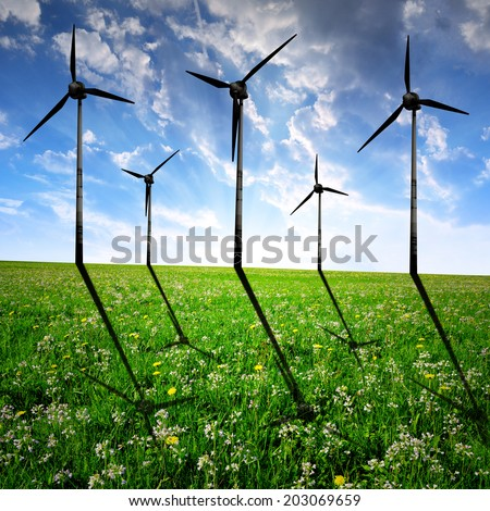 wind turbines on meadow in the sunset