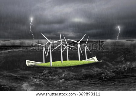 Wind turbines on money boat with wave and storm floating in the ocean - stock photo