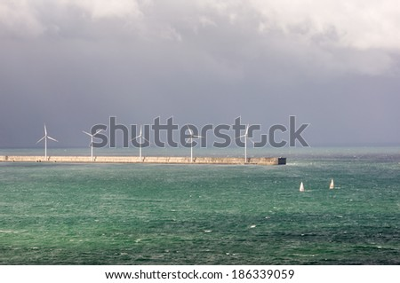 wind turbines on the sea - stock photo