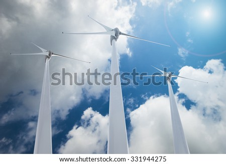 Wind Turbines over clouds and sunlight - stock photo