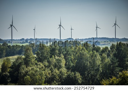 Wind turbines photographed at landscape, propeller of wind turbine in the frame.  - stock photo