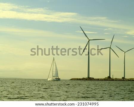 wind turbines power generator farm for renewable energy production along coast baltic sea near Denmark. Alternative green clean energy, ecology. - stock photo