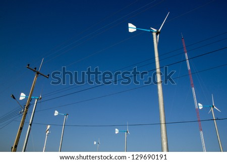 Wind turbines produce electricity. - stock photo