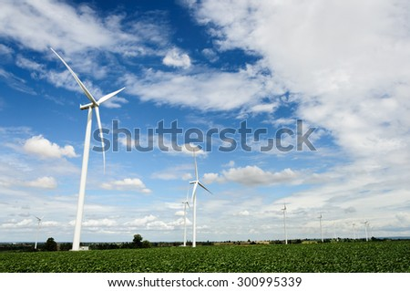 Wind turbines produce electricity Alternative energy  with sky and cloud background - stock photo