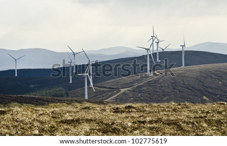 Wind turbines providing a sustainable source of energy - stock photo