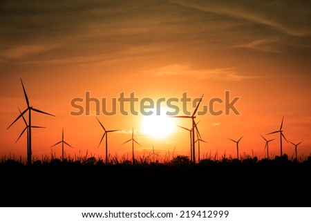 Wind turbines silhouette at sunset