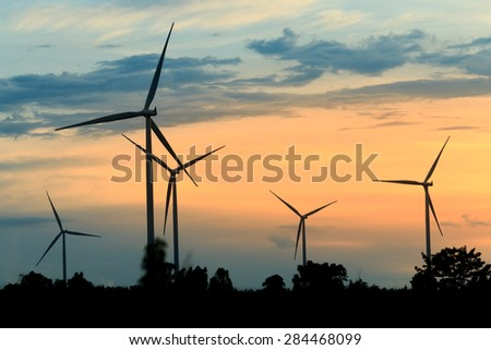 Wind turbines silhouette at sunset in Thailand - stock photo