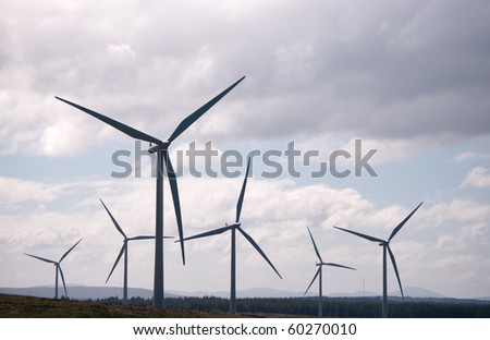 Wind turbines silhouetted on a wind farm in Scotland, Europe.