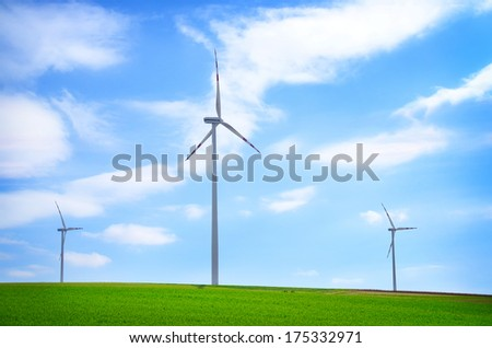 Wind turbines under a clear blue sky - stock photo