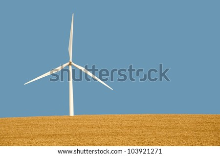 Wind turbines under a clear blue sky in Washinton State - stock photo