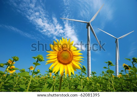 Wind turbines under blue cloudy sky