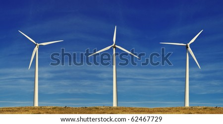 Wind turbines - under the summer blue sky - stock photo