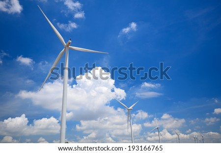 Wind Turbines with Blue Sky and Clouds - stock photo