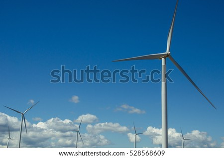 wind turbines with blue sky background