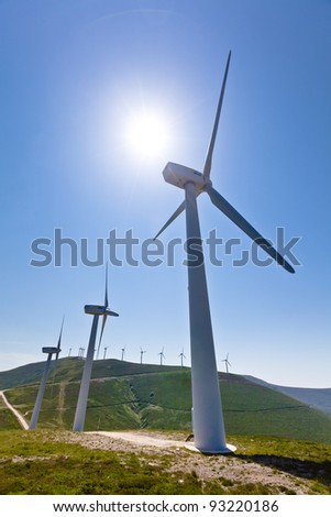 Wind turbines with more behind, vertical shot, copy space