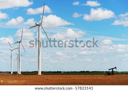 Wind Turbines with old oil well pump in Sweetwater ,Texas - stock photo