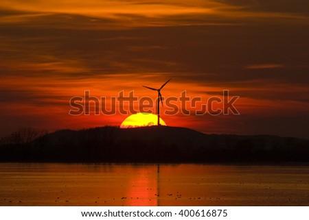 wind wheel at sunsetl, bavaria, germany - stock photo