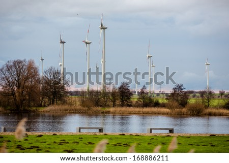 wind wheels in the background of a sea -  Salzgitter, Germany    - stock photo
