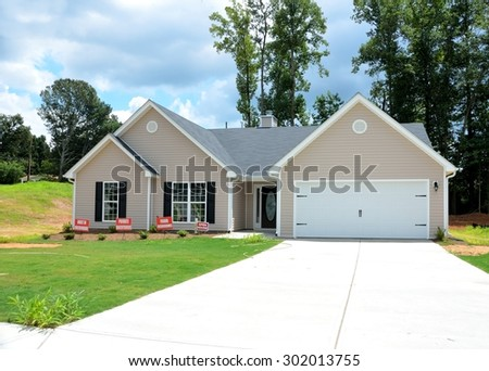 WINDER, GEORGIA, USA - JULY 24, 2015: Home construction is picking up at local counties in Georgia. Shown is a new model home at development in Winder, Georgia. - stock photo
