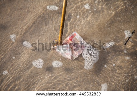 windfall in the sea. Money floating in the water - stock photo