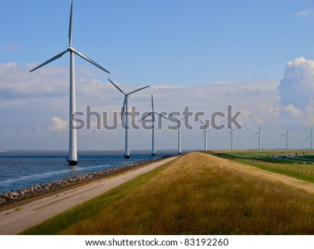 Windfarm along the coast seen from the top of a dike - stock photo