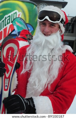 WINDHAM, NY -  DECEMBER 19: Unidentified skiers take to the slopes during the Skiing and Riding Santas charity at Windham Mountain in Windham, NY on December 19, 2010. Skiers must be in full Santa costume to participate and proceeds benefit the local food