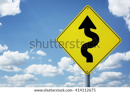Winding arrow road sign concept for business difficulties, problems and confusion - stock photo