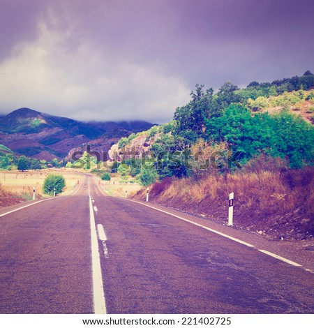 Winding Asphalt Road in the Cantabrian Mountains, Spain, Instagram Effect - stock photo
