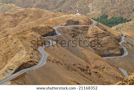 Winding asphalt road over Tichka pass in Atlas  mountain, Morocco