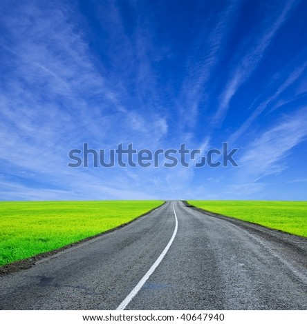 winding asphaltic road - stock photo