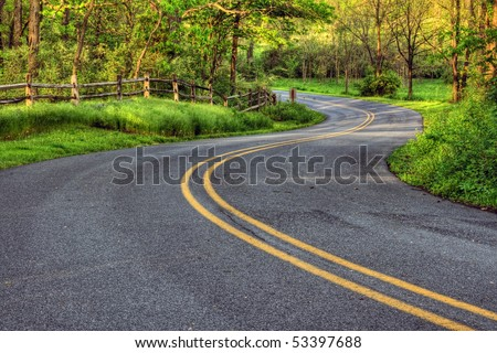 Winding Country Road in Southeastern Pennsylvania. - stock photo