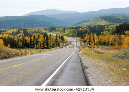 Winding country road in the elbow river valley, alberta, canada - stock photo
