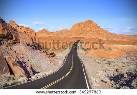 Winding desert highway, travel adventure concept, Valley of Fire State Park, Nevada, USA.