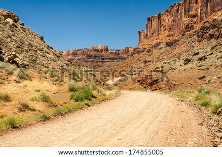 Winding Desert Road and Blue Sky - stock photo
