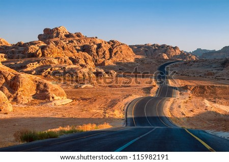 Winding desert road in Wadi Rum, Jordan - stock photo
