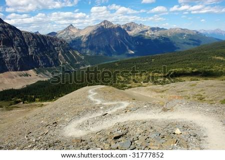 winding hiking trail beside mountain edith cavell, jasper national park, alberta, canada - stock photo