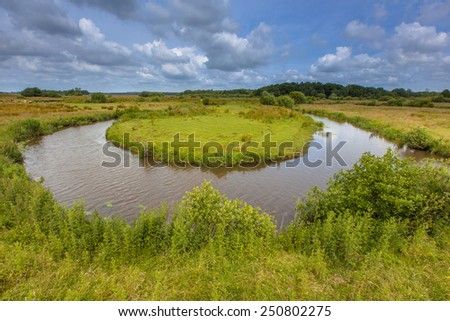 Winding meandering lowland river Drentse Aa in a National Park in the Netherlands - stock photo