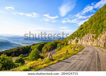 Winding mountain road in Balkan Mountains (Stara planina), Bulgaria. The road to peak Okolchitsa. - stock photo