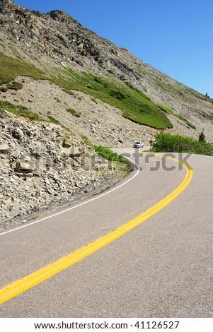 Winding mountain road in glacier national park, montana, usa - stock photo