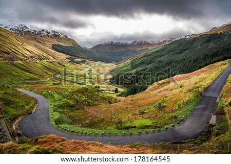 Winding mountain road over a canyon