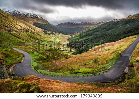 Winding mountain road over a canyon - stock photo