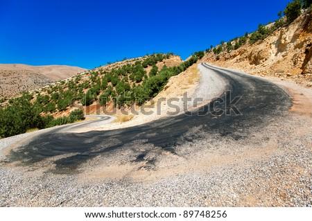 Winding mountain serpentine road - stock photo
