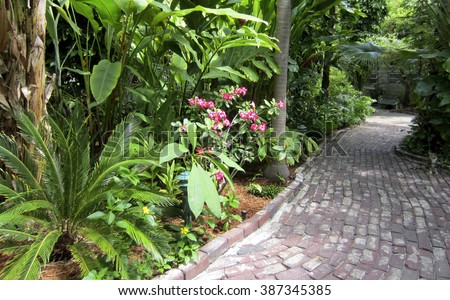 Winding path through the gardens and grounds of the Hemingway House and Museum in Key West, Florida. - stock photo
