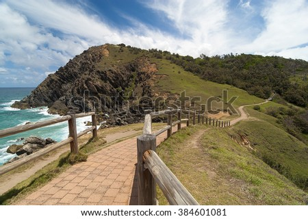 Winding path to the lighthouse | Cape Byron  Cape Byron is the easternmost point of mainland Australia and only minutes away by walk from the town of Byron Bay. - stock photo