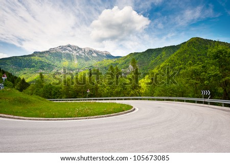 Winding Paved Road in the Italian Alps - stock photo