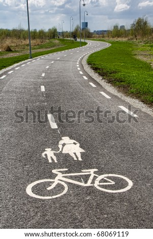 Winding pedestrian road for walkers and bicycles, mother with child and bike sign on the road - stock photo