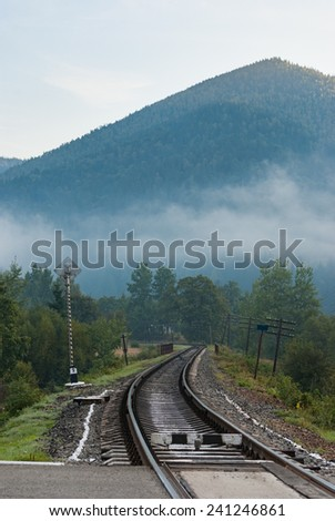 winding railroad in the mountains - stock photo
